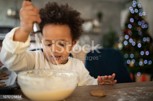 Adorable Little Girl Mixing Eggs And Ingredients For Cookies All By Herself