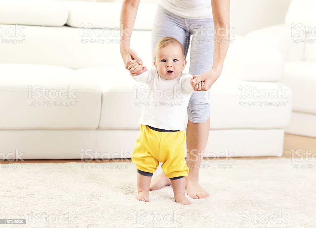 First Steps - mother and child stock photo