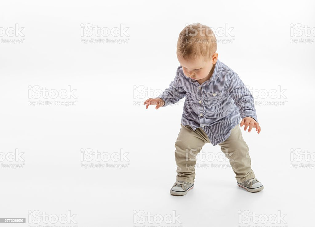 First steps of a baby boy stock photo