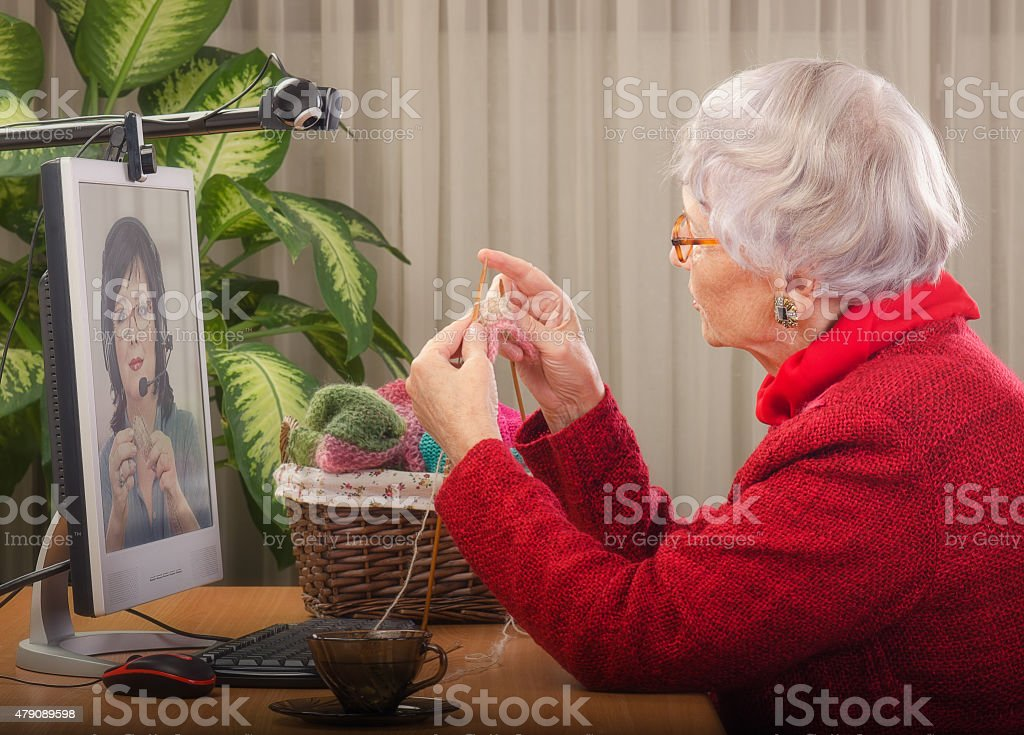 First steps of learning to knit online stock photo