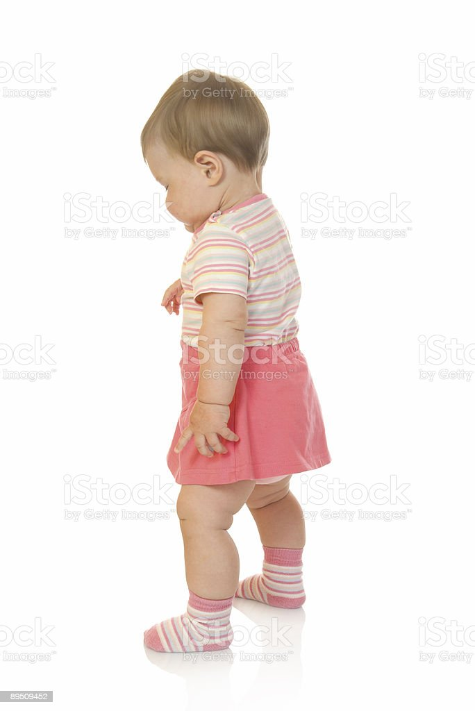 First steps of small baby in red dress royalty-free stock photo