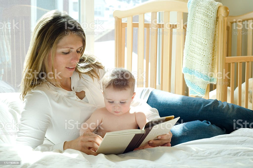 First Story Book For a Baby and Mother stock photo