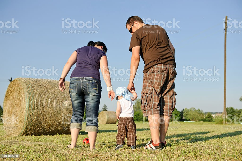 First walk with their son royalty-free stock photo