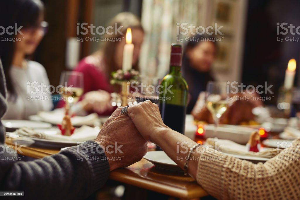 First we pray then we feast stock photo