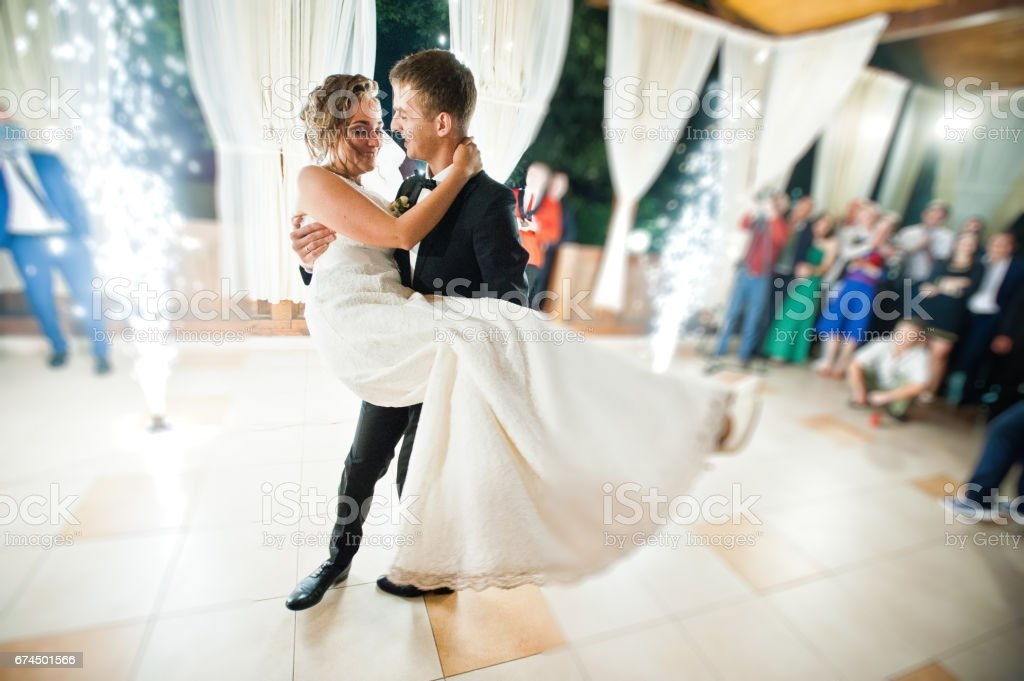 First wedding dance with fireworks of wedding couple. Photo with blur and noise stock photo