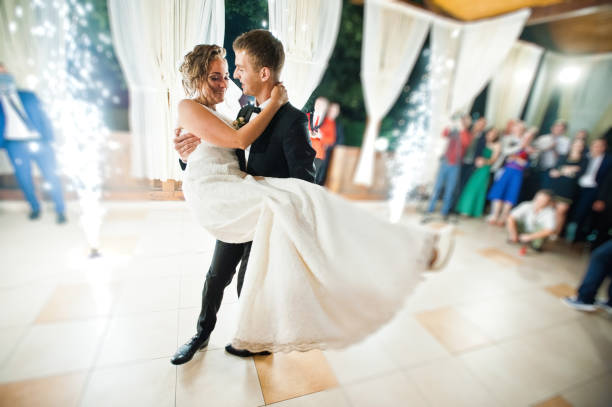 first wedding dance with fireworks of wedding couple. photo with blur and noise - dance floor stock photos and pictures
