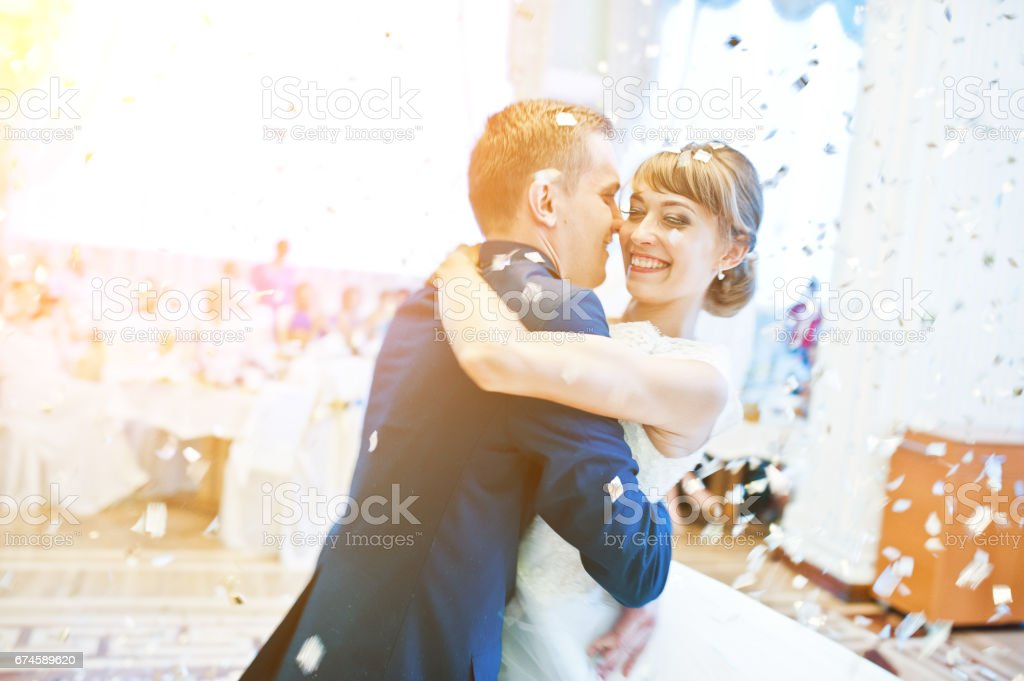 First wedding dance with golden confetti stock photo