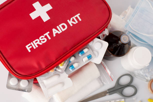 First-Aid kit with all essential elements First-Aid kit is an important part of safety in emergancy situations first aid stock pictures, royalty-free photos & images