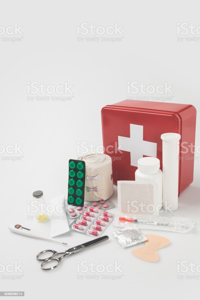 first-aid kit with medical supplies stock photo