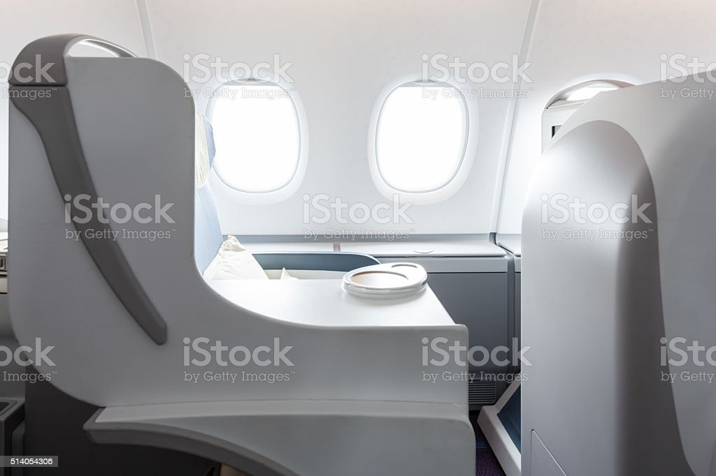 First-class cabin in airplane stock photo