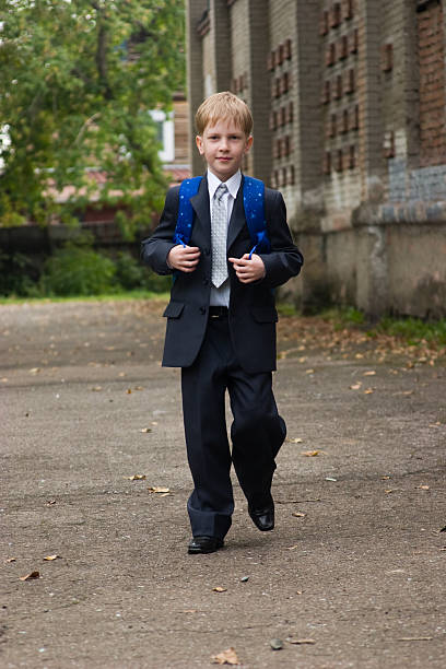 First-form boy goes to school. stock photo
