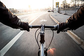 First-person view of cyclist at morning