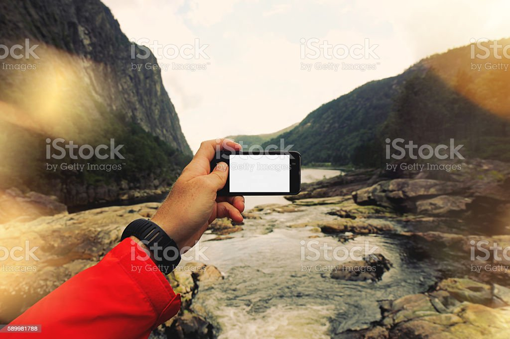 First-person view, the man takes a photo stock photo