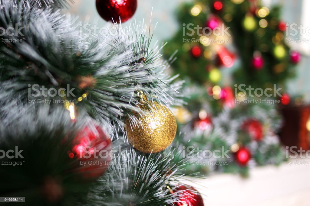 Fir-tree with Christmas toys. New Year decoration. A Christmas decorative of A Christmas tree with a beautiful bokeh background stock photo