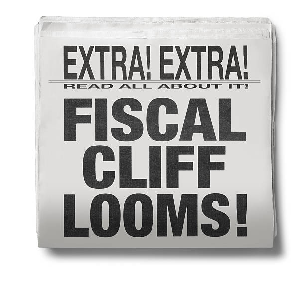 Fiscal Cliff Looms A newspaper with the headline