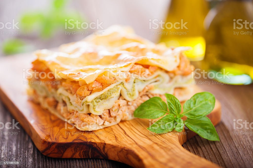 Fish and broccoli lasagna Fish and broccoli mousse lasagna on a wooden table Basil Stock Photo