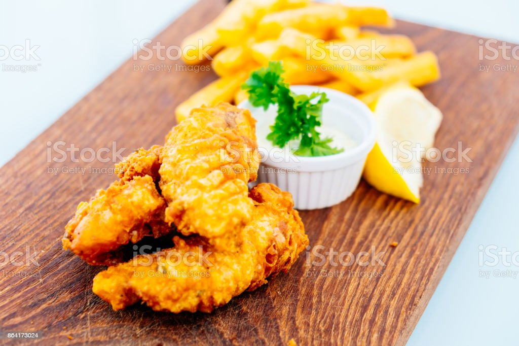 Fish and chip with french fries royalty-free stock photo