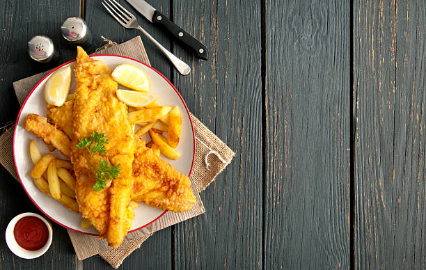 fish and chips background - bakken stockfoto's en -beelden
