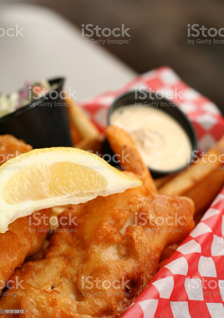 Fish and Chips Detail with Lemon Slice, Cream stock photo