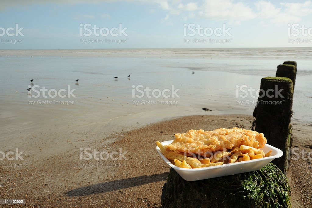Fish and chips dish on a sea shore stock photo