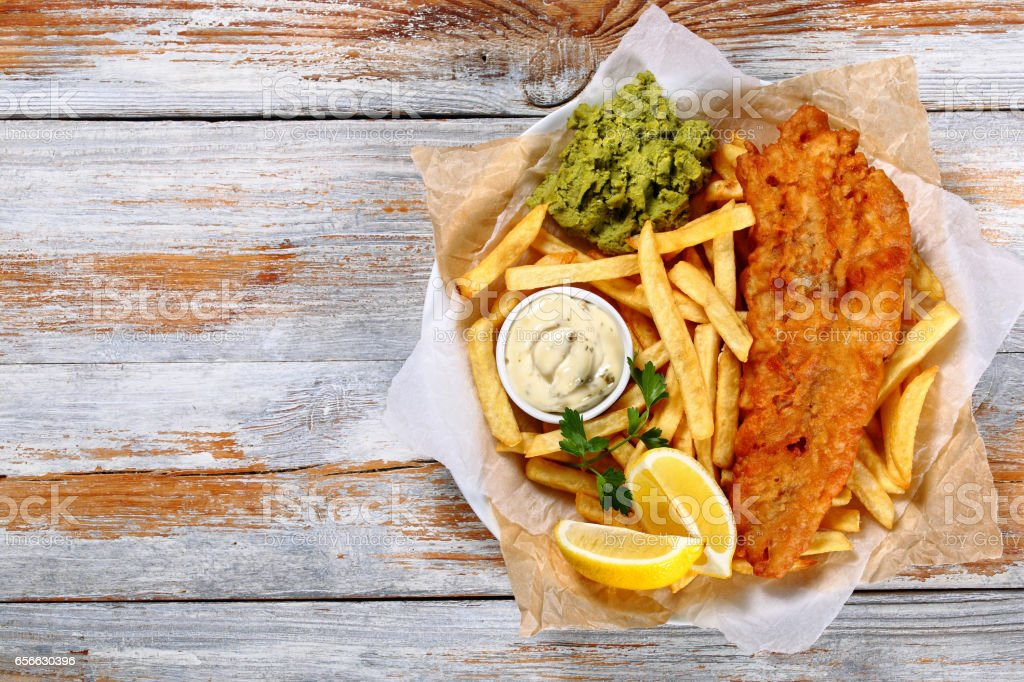 fish and chips - fried cod, french fries stock photo