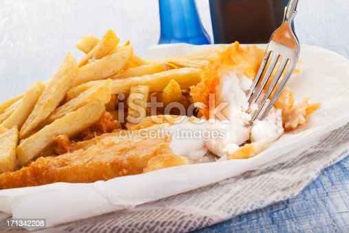 Traditional english fish and chips served in newspaper.