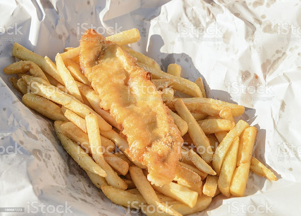 Fish and Chips in Traditional Paper Wrapping stock photo