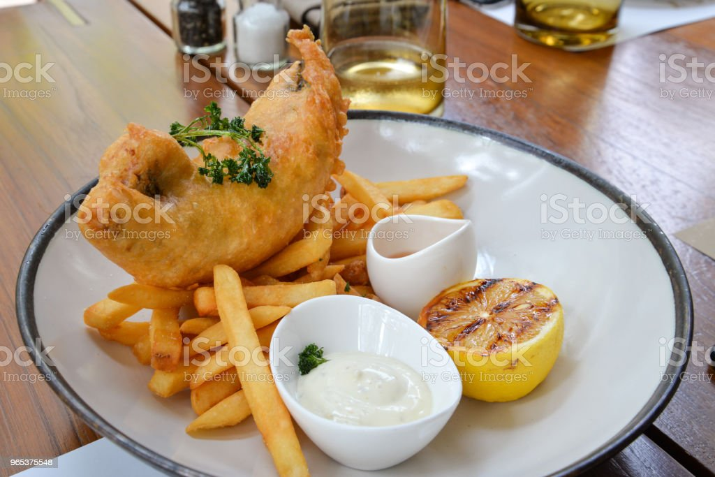 Fish and chips on a plate royalty-free stock photo