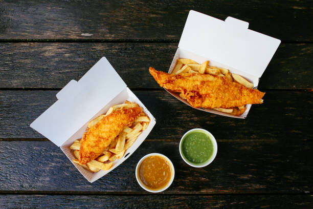 Fish and chips on the wooden table stock photo