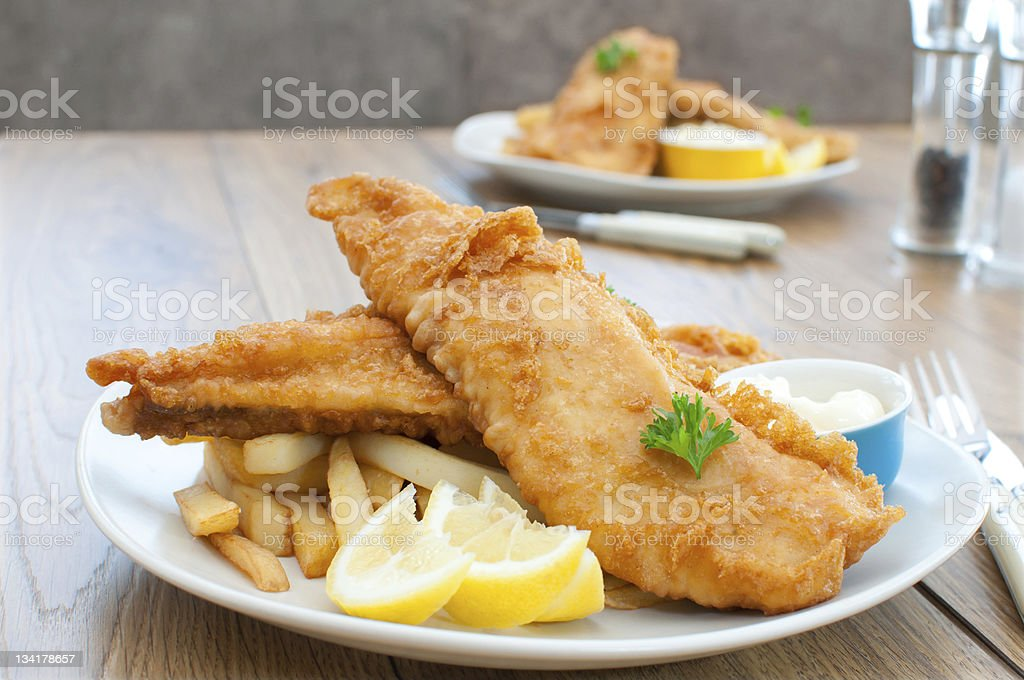 Fish and chips Traditional plate of fish and chips Batter - Food Stock Photo
