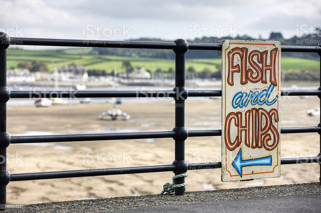 Fish and chips sign at typical UK seaside resort stock photo