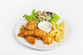 Fish and chips with french fried, and dipping sauce on white background