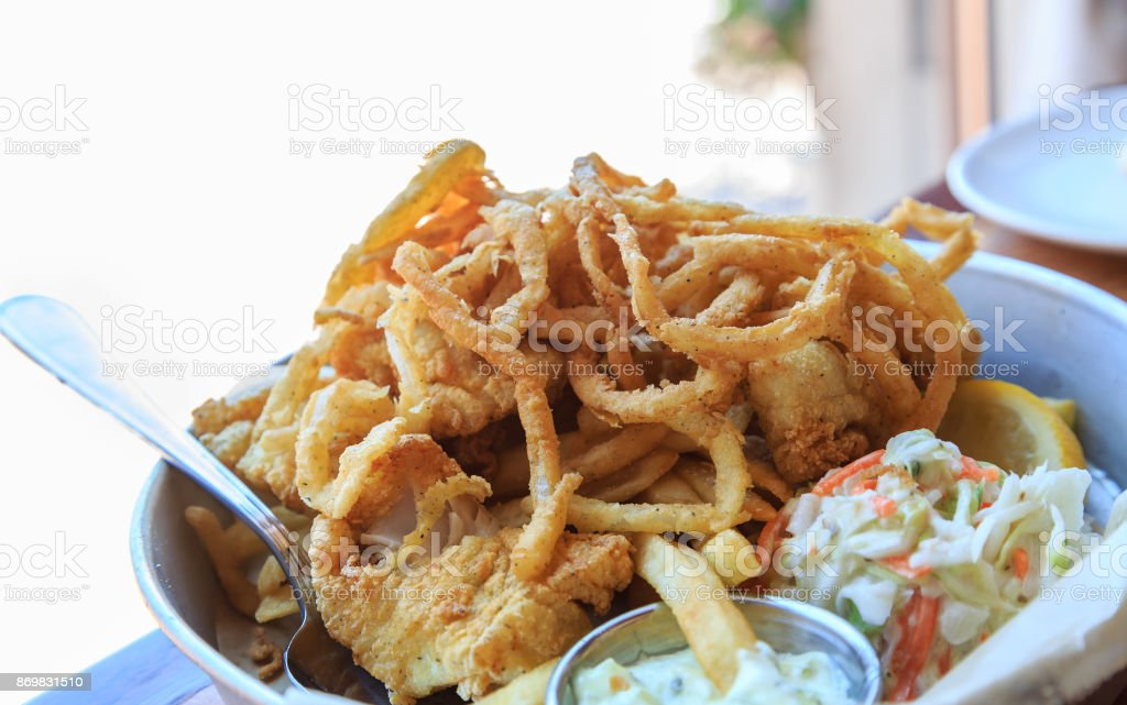 Fish and Chips with Onion Strings and Coleslaw stock photo