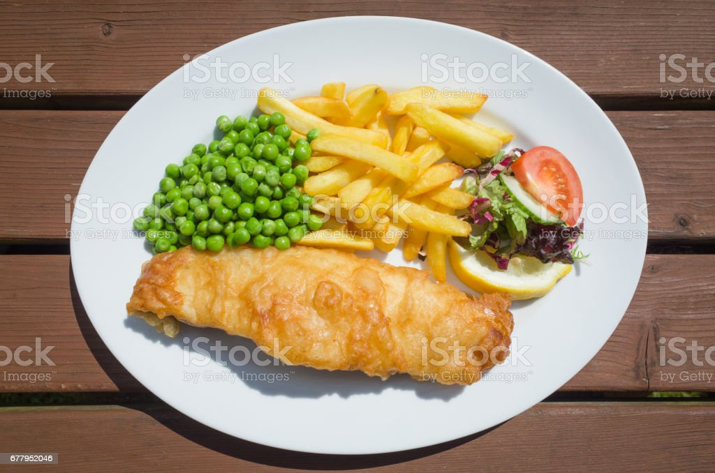 Fish and Chips with Peas on a Plate stock photo