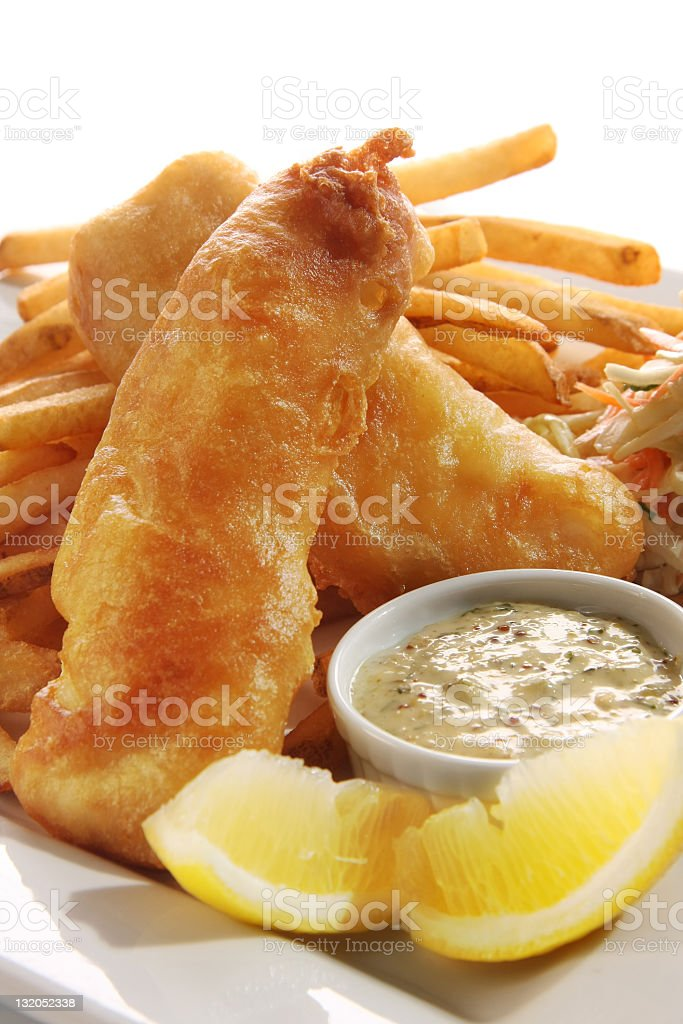 Fish and chips with sauce and lemon stock photo