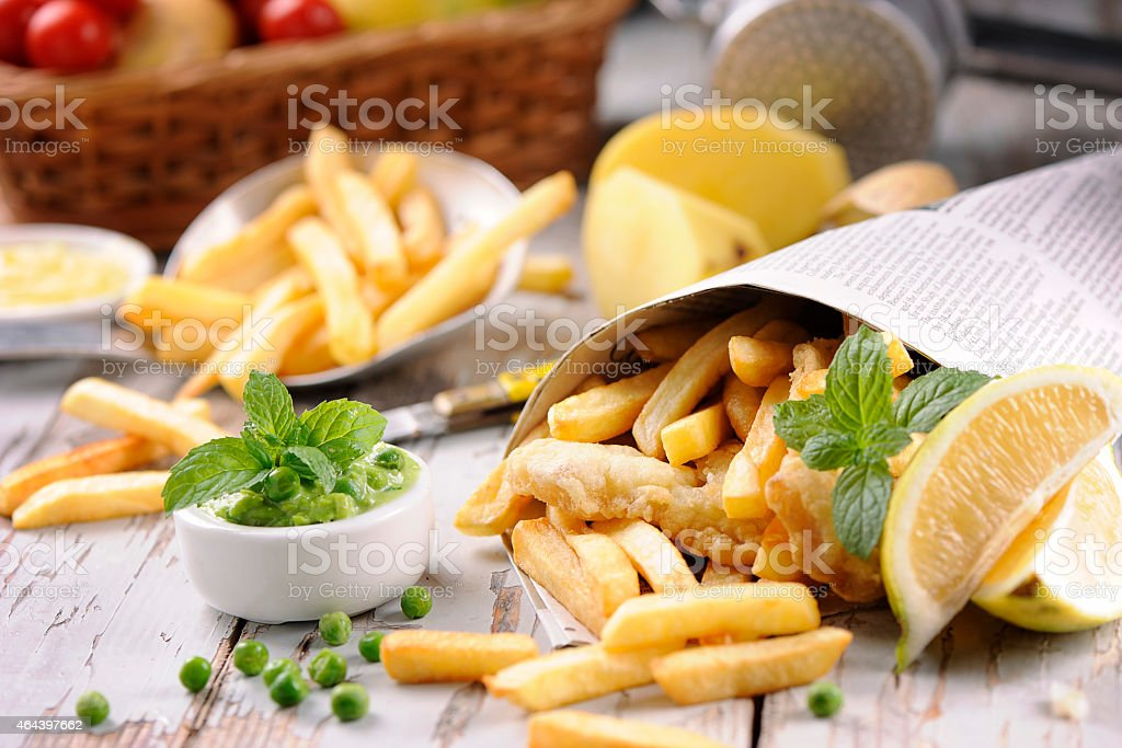 Fish and chips wrapped in newspaper stock photo