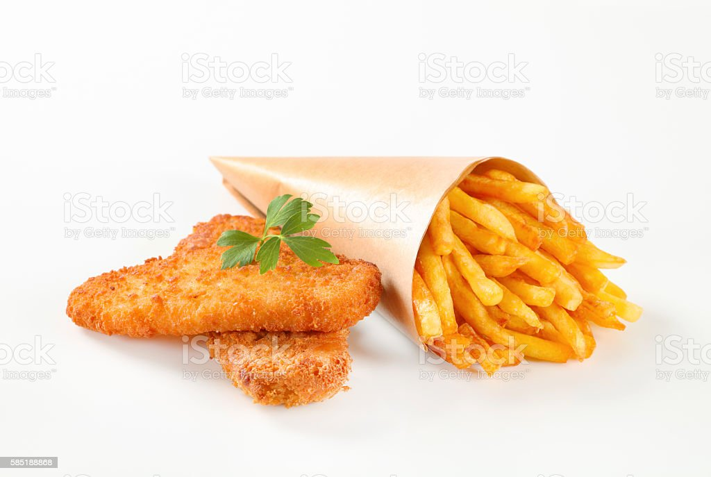 fish and chips wrapped in paper cone stock photo