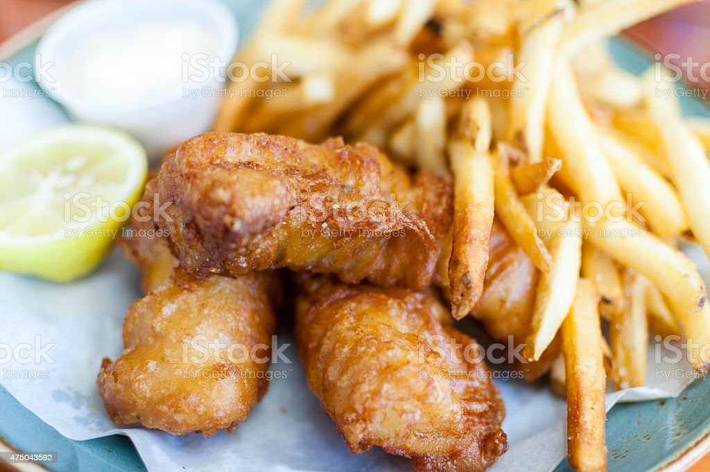 Fish and chips/fries on a plate stock photo