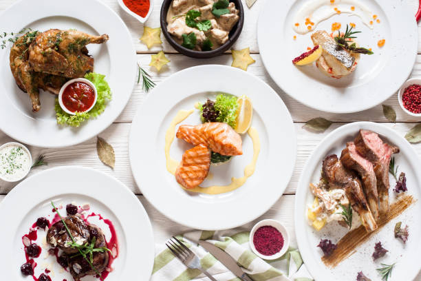 Fish and meat meals variety flat lay Fish and meat meals variety flat lay. Top view on buffet with assortment of healthy hearty food. Buffet, banquet, appetizer, restaurant menu concept european culture stock pictures, royalty-free photos & images