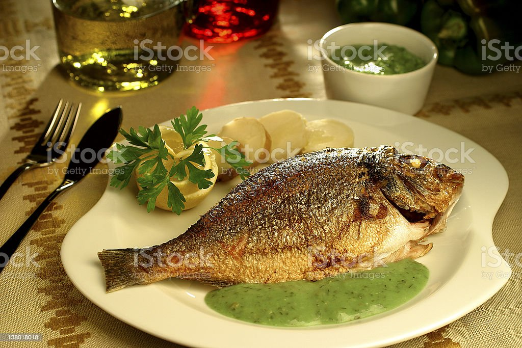fish and potatoes with salsa verde royalty-free stock photo