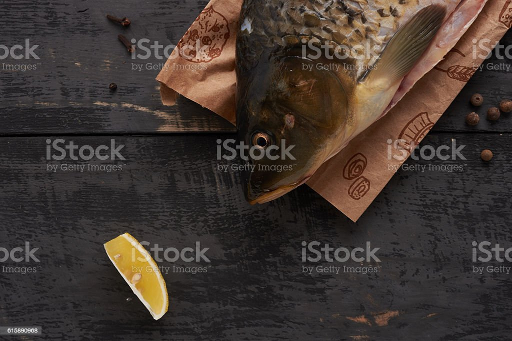 fish and slice of lemon on the table stock photo