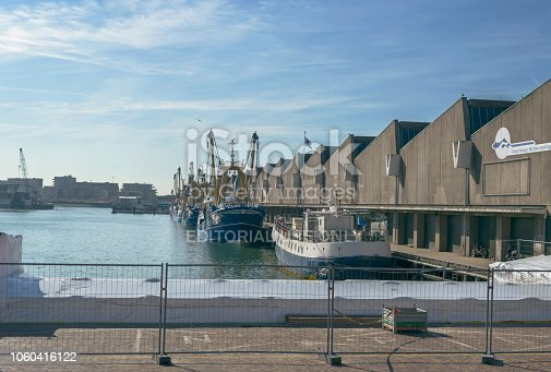 istock Fish Auction Scheveningen B.V. and fishing vessels on sunny day 1060416122