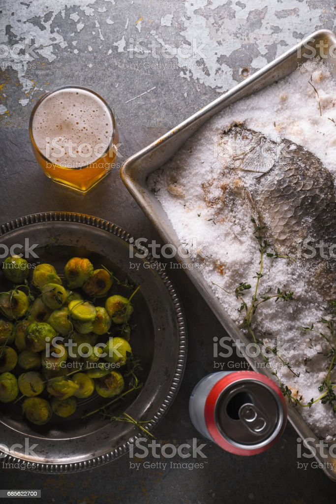Fish baked in salt with Brussels sprouts  and beer royalty-free 스톡 사진