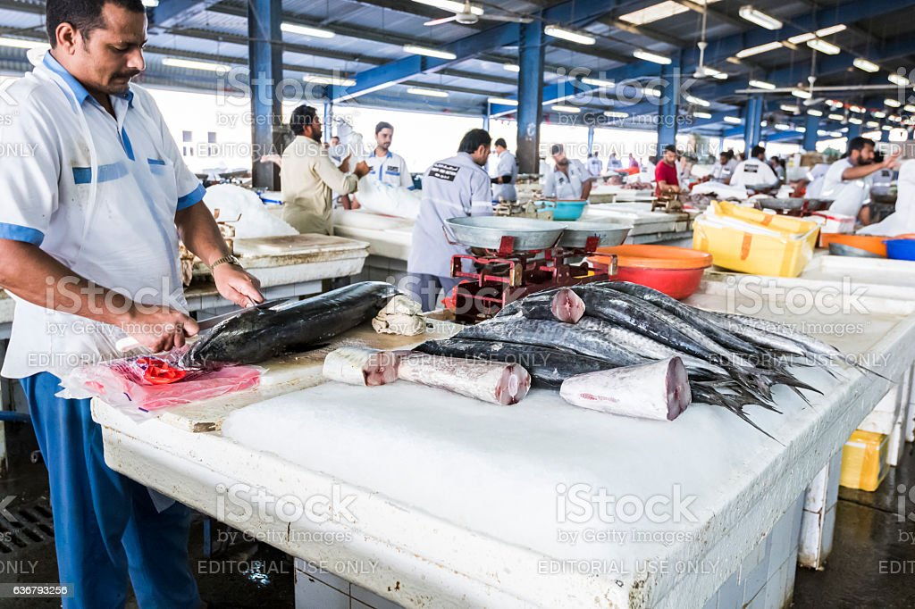 Fish Being Deskinned At Dubai Fish Market Stock Photo
