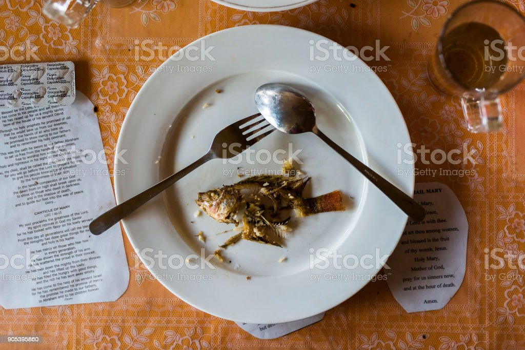 Fish bones on a finished dinner plate stock photo