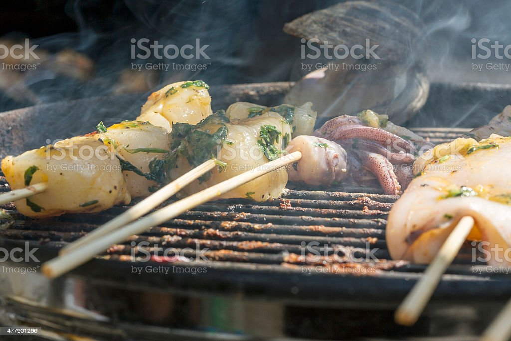 Fish, clam and seafood cooked on a grill stock photo