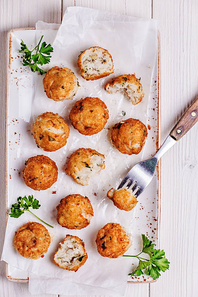 Fish croquettes on  white  background. Fish croquettes on  white wooden background. fritter stock pictures, royalty-free photos & images