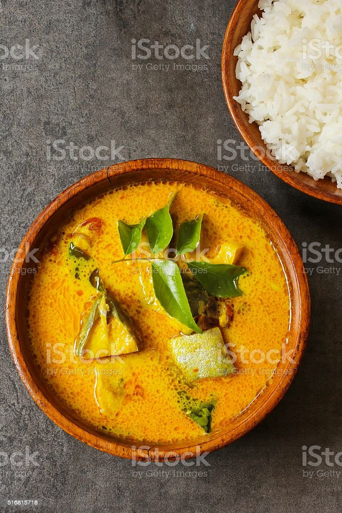 Fish curry in coconut milk stock photo