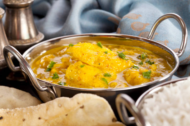 Fish Curry Fish Curry - a balti dish with fish curry in a yoghurt sauce with green chilli, served with rice and poppadums. Fish is basa. balti dish stock pictures, royalty-free photos & images