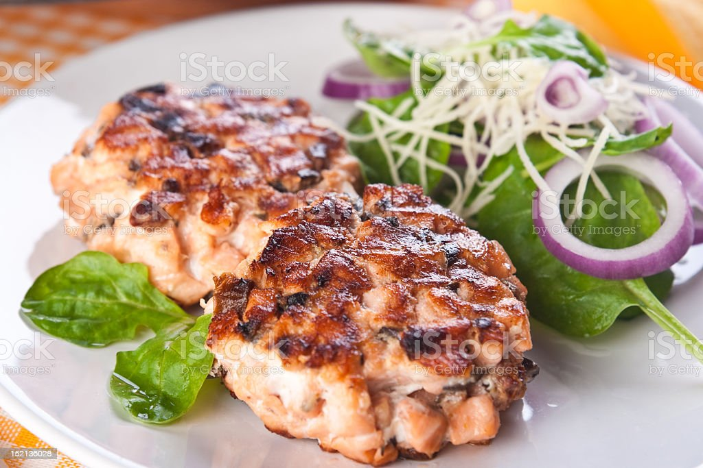 Fish cutlet with a salad of spinach (no sauce) royalty-free stock photo